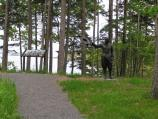 This wayside exhibit and bronze statue mark the sixth stop along the interpretive trail.