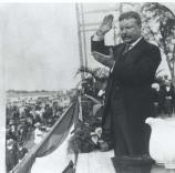 Theodore Roosevelt seen in a gesture typical of his speechmaking.