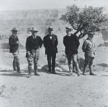 Theodore Roosevelt (second from left) and his party posing at the rim of the Grand Canyon.