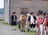 Civilians and soldiers in 18th century clothing