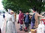 men and women dressed in colonial clothing
