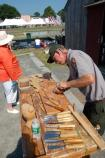 National Park Service carpenter John Pyndynkowski demonstrates traditional carving methods as he makes decorations for the transom of the replica tall ship Friendship of Salem at the 2007 Salem Maritime Festival