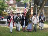 A group of re-enactors drill to practice their role as a military honor guard as part of the Battle of Pell's Point Encampment at St. Paul's Church NHS.