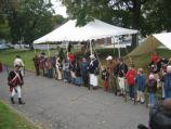An officer reviews his troop of re-enactors and young visitors during the Battle of Pell's Point Encampment at St. Paul's Church NHS.