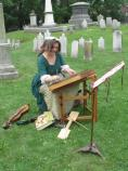Re-enactor and musician Linda Russell performs a song from the 18th Century on a dulcimer in the cemetery of St. Paul's Church NHS.