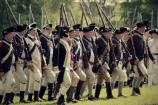 A line of American soldiers in well-ordered Revolutionary War uniforms.
