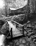 VA-119-68	CAMP HOOVER. PRESIDENTS CABIN. WOODEN BRIDGE IN FOREGROUND. LOOKING WEST.  More about HAER Photo Documentation...