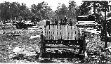VA-119-104	Catalog H History 1, C.C.C., 73 Picnic Furniture Construction, Negative No. 882 1 ca. 1936 WOOD UTILIZATION. COMPLETED RUSTIC BENCH MADE BY CCC ENROLLEES AT CAMP NP 3 FOR USE AT PARKING OVERLOOKS AND PICNIC GROUNDS. NOTE SAW IN BACKGROUND USED FOR HALVING CHESTNUT.