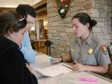 A ranger discusses with visitors options for enjoying their visit to Shenandoah National Park