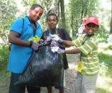 Proud of a job well done - one of many bags of invasive plants pulled by campers!
