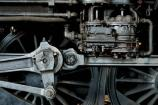 Part of the mystique of steam locomotives is that the moving parts are visible. The air pump supplies compressed air for the brake system. The rods connect the piston with the wheels and the wheels with the valve timing gear. All of this is visible when a steam locomotive moves.