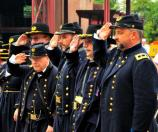 Costumed Civil War characters salute