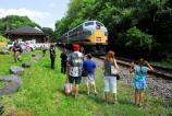 Railfans observe as passengers reboard 2013 Founder's Day train
