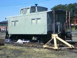 Lehigh Valley #95003 caboose is shown prepped in gray primer before receiving it first color coat during cosmetic restoration.