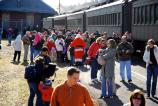 Santa's many fans, young and young-at-heart, gather near the Moscow passenger station during a