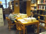 Resource Management VIPs Madison Bradley and Chelsea Martin assist with organizing archival material