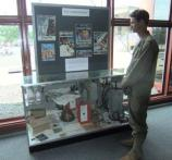 A reenactor views a WWII memorabilia exhibit during the Memorial Day weekend tribute.