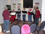 Singers entertain park visitors at Thomas Stone's Christmas Candlelight Tour.