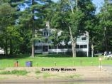 11 View of Zane Grey Museum from river