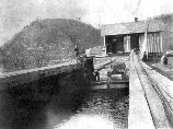Once inside the lock the gates would be shut and the boat raised (as in this case) or lowered to the next level. This photograph shows Hoag's Lock near Neversink, northeast of Port Jervis. This boat is loaded with coal and traveling towards Rondout.