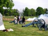 Continental Soldiers demonstrating the firing procedures of a revolutionary war cannon.