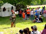 Members of the Oneida Indian Nation talk to visitors and discuss the role of the Oneida Indian Nation in the Revolutionary War.