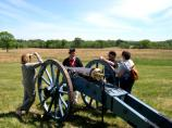 Visitors and park volunteer with a cannon