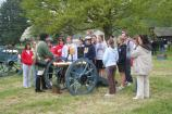 Visitors learn about the cannons from a member of the Oneida Indian Nation.