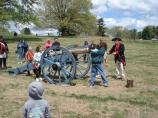 Children are given the opportunity to pretend to load and fire the 9 pounder artillery piece.