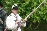 A soldier cleans his musket between programs.