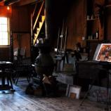 Interior of Young Studio, northeast corner. Sperry Andrews' paintings in right corner. Young's sculpture behind stove.