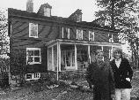 Sperry and Doris Andrews stand in front of the house in Branchville, Connecticut.