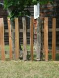 The newly restored rustic fence sits in front of the barn.