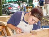 A young woman carries on traditional carpentry skills.