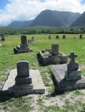 Papaloa Cemetery with Pali in the Background at Kalaupapa and Kalawao Settlements