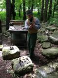 Park Ranger in period costume demonstrating stone cutting