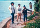 American Indian children walking by the bay.