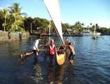 Students prepare to sail canoe
