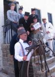 A group of Living History VIPs posing in front of the Lighthouse during Founder's Day 2014
