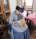 Living History Volunteer Suzann dressed in period clothing in the Old Point Loma Lighthouse