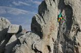 A colorful climber ascends the granite rock called The Anteater