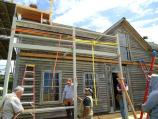 Preservation crew members 1/2 way through the framing of the Ferry House porch.
