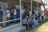 Participants of the 2011 preservation field school standing on the new ferry house porch.