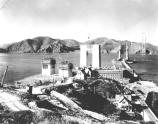 This photo shows the Golden Gate Bridge under construction. Notice how Fort Point has been surrounded by the construction project. All of the lighthouse keepers' residences were ultimately demolished to make way for the bridge on-ramp.