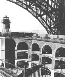This photo, taken around 1947, shows the southeast corner of the barbette. Notice how the fort is tucked right under the special arced bridge span that was designed specifically to protect the fort.