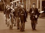 Photo of Civil War reenactors at Fort Point walking in formation.