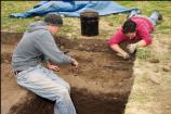 Students excavate a site as part of the site's 2005 Archaeology Field School.