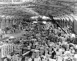 This 1921 photo of Pier 2 shows just an average daily amount of the tremendous military cargo required for overseas. Cargo shipped overseas originated at points throughout the continental United States, often times requiring a long journey to port. During the war, San Francisco Port of Embarkation personnel were responsible for the logistics of moving all the cargo along.