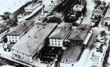 This photo, circa 1930s, now shows all three piers constructed, as well as the five large administrative and storage buildings. This photo well illustrates how the ships are docked on both sides of the piers so that they can access the cargo more easily.