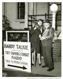 """Gala expo."" Woman holding ""handy talkie"" with man in hat, July 29, 1946."
